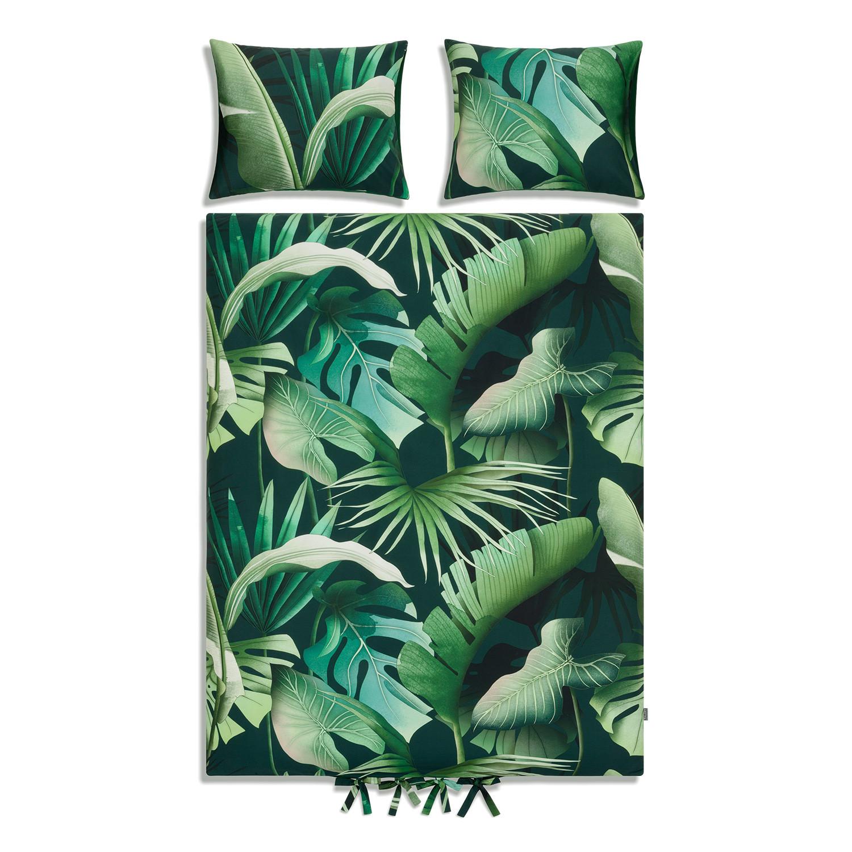Dwustronna pościel z ręcznie malowanym wzorem liści rodem z tropikalnych lasów Stworzona dla tych którzy pragną zatracić się w bujnej tropikalnej zieleni Wzór naszej pościeli to unikatowa kompozycja liści drzew rosnących w odległych tropikalnych lasach Nie od dziś wiadomo że odcienie zieleni wpływają na nas niezwykle uspakajającą oraz odprężająco Dzięki temu wzorowi nasze zmysły oraz wyobraźnia powędrują do tętniącej życiem dżungli zapewniając nam ukojenie nerwów oraz spokojny sen Wzór Tropikalny Las powstał w ramach współpracy z utalentowaną polską artystką Agatą Wierzbicką 100 bawełny o splocie satynowym gramatura 140 g m 2 tkanina oraz nadruk posiadają certyfikat Oeko Tex Standard 100 klasy I który gwarantuję że pościel nie wywołuje podrażnień Jest bezpieczna dla niemowląt oraz alergików poszewki na poduszki z dyskretną zakładką poszewka na kołdrę wiązana na ozdobne troczki ręcznie malowany wzór przez polską projektantkę pościel uszyta w rodzimej szwalni komplet nie obejmuje wypełni