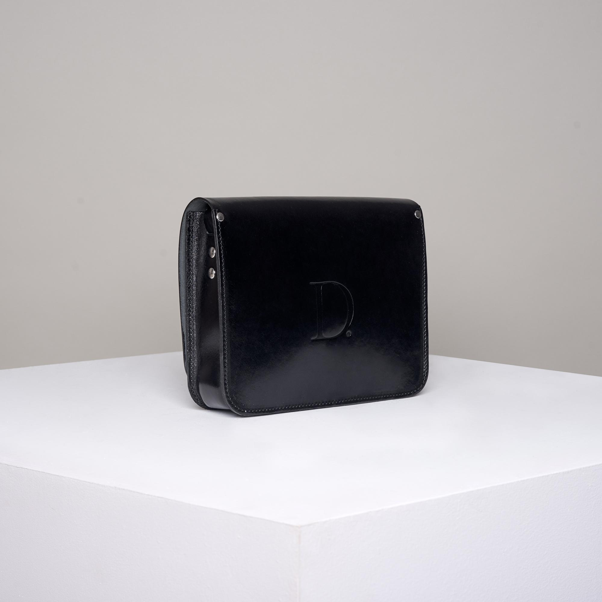 Czarna skórzana torebka rozmiar - Departament.Store