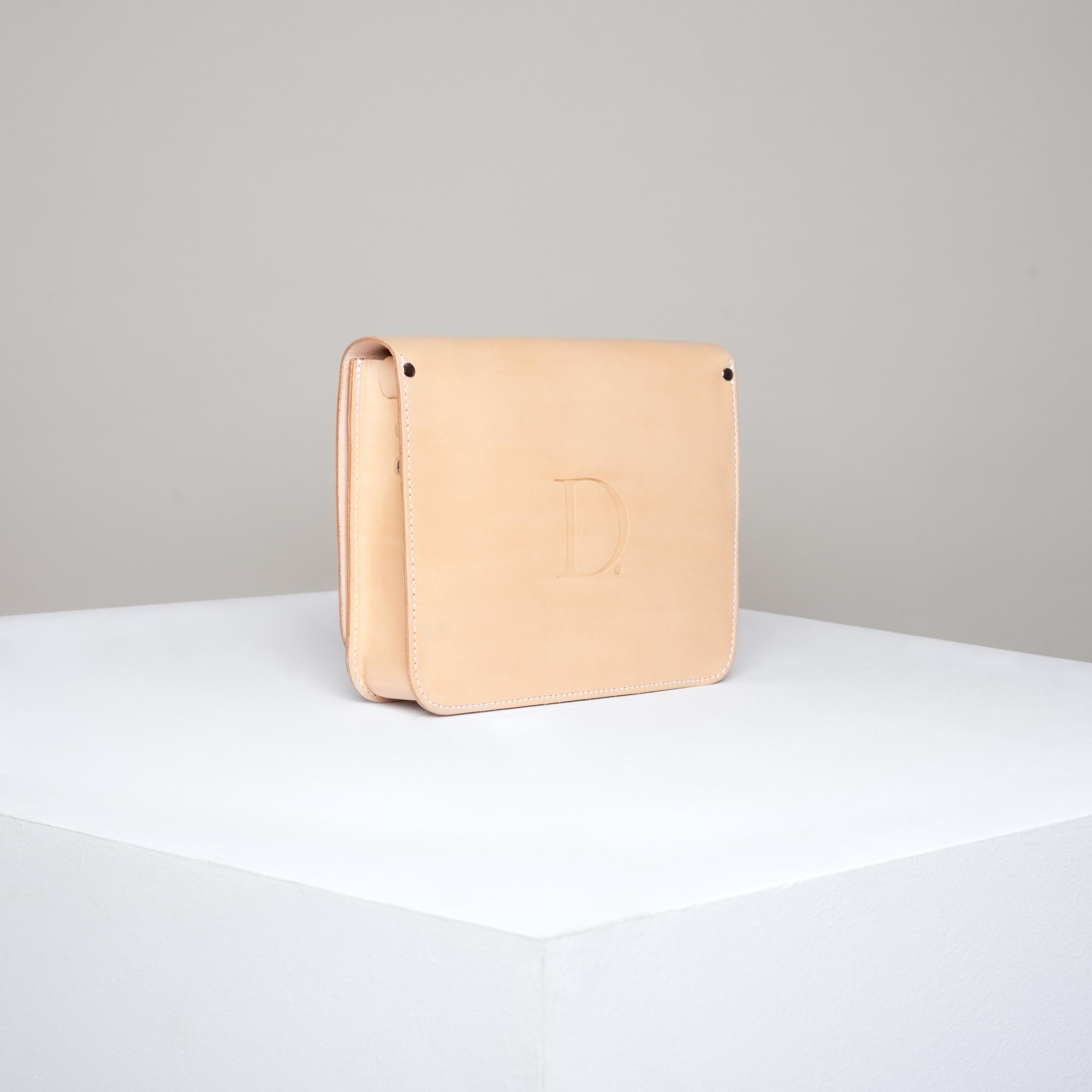 Skórzana torebka rozmiar M jasny beż - Departament.Store
